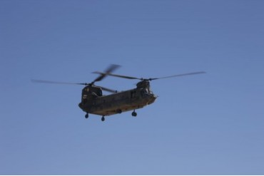CH-47 Chinook flies over Playas Training Area, New Mexico.