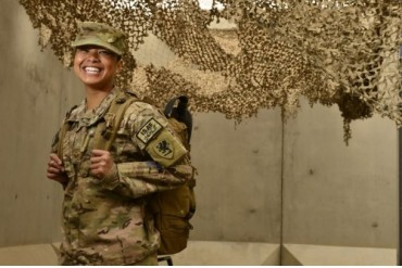 U.S. Air Force combat medic smiles before a pre-convoy briefing.