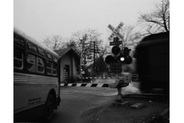 USA, New York City, Staten Island, West Shore, Bus waiting at rail crossing