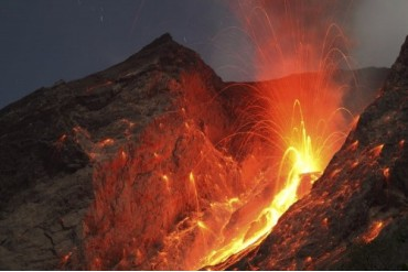 Strombolian type eruption of Batu Tara volcano, Indonesia.