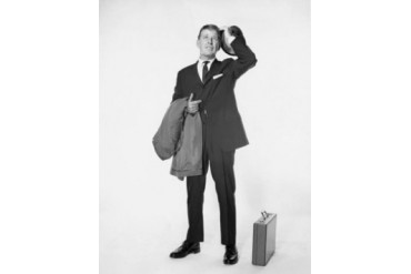 Mature businessman holding hat and overcoat Poster Print (18 x 24)
