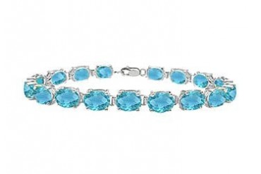 Sterling Silver Prong Set Oval Blue Topaz Bracelet with 15.00 CT TGW