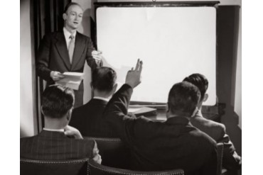 Businessman giving a presentation in a seminar Poster Print (24 x 36)