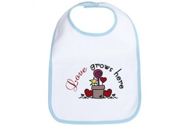 Love Grows Here Holiday Bib by CafePress