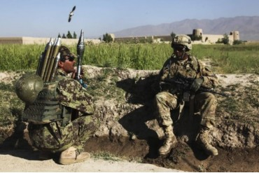 U.S. Army soldier takes a break with an Afghan National Army soldier.