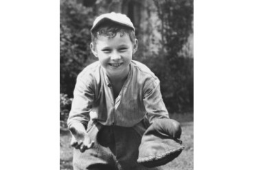 Boy wearing a baseball glove Poster Print (18 x 24)