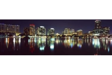 Buildings lit up at night in a city, Lake Eola, Orlando, Orange