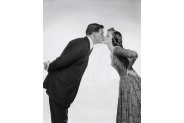 Side profile of a young couple kissing Poster Print (18 x 24)