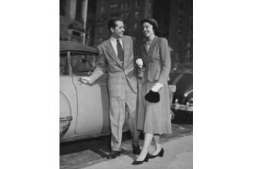 Young couple standing near car Poster Print (18 x 24)