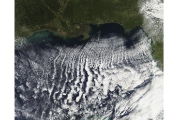 Cloud streets are visible stretching out into the Gulf of Mexico.