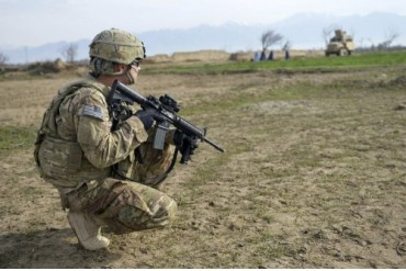 U.S. Soldier patrols a village in Afghanistan.