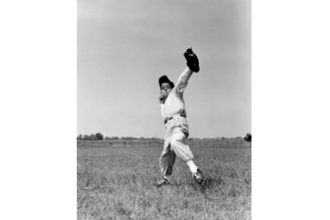 Boy preparing to throw ball inn baseball Poster Print (24 x 36)