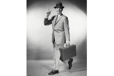 Portrait of a businessman carrying a briefcase Poster Print (18 x 24)