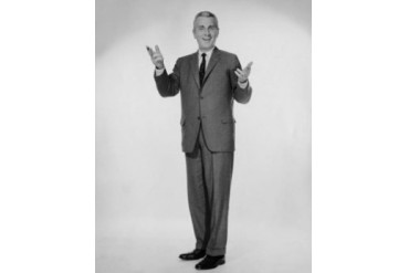Studio portrait of businessman gesturing Poster Print (18 x 24)